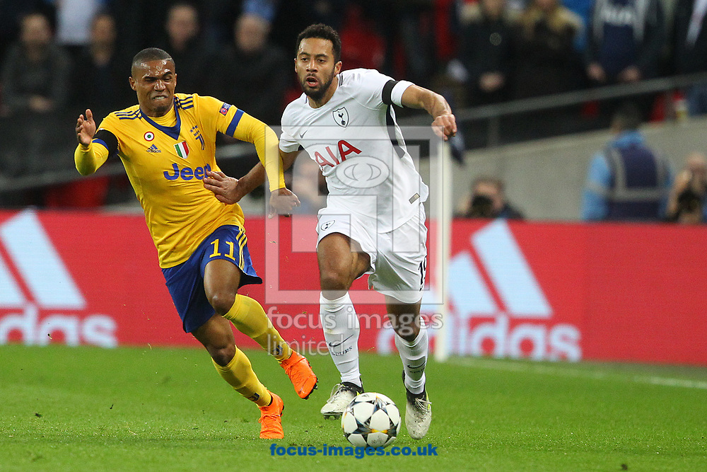 Douglas Costa of Juventus and Mousa Dembele of Tottenham Hotspur in action during the UEFA Champions League match at Wembley Stadium, London<br /> Picture by Paul Chesterton/Focus Images Ltd +44 7904 640267<br /> 06/03/2018