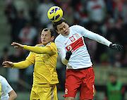 Warsaw 22/03/2013.Poland vs Ukraine FIFA 2014 World Cup qualifying football match in Warsaw, on March 22, 2013.Ukraine's Wiaczeslaw Szewczuk fights for ball with Poland's Sebastian Boenisch (R).Photo by : Piotr Hawalej
