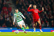 Callum McGregor (#42) of Celtic takes the ball away from Dominic Ball (#21) of Aberdeen during the Betfred Cup Final between Celtic and Aberdeen at Celtic Park, Glasgow, Scotland on 2 December 2018.