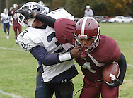 Cornwall-on-Hudson, New York - A New York Military Academy running back tries to hold off a Harvey School defender during a high school football game on Oct. 17, 2009.