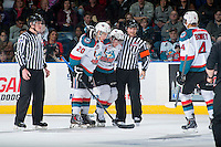 KELOWNA, CANADA - FEBRUARY 28: Referee Chris Crich and Gage Quinney #20 assist Josh Morrissey #27 of Kelowna Rockets  on February 28, 2015 at Prospera Place in Kelowna, British Columbia, Canada.  (Photo by Marissa Baecker/Shoot the Breeze)  *** Local Caption *** Chris Crich; Josh Morrissey; Gage Quinney;