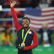 Gymnastics - Olympics: Day 6 Simone Biles of the United States on the podium with her gold medal after winning the Artistic Gymnastics Women's Individual All-Around Final at the Rio Olympic Arena on August 11, 2016 in Rio de Janeiro, Brazil. (Photo by Tim Clayton/Corbis via Getty Images)