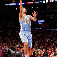 06 October 2013: Denver Nuggets shooting guard Evan Fournier (94) goes for the layup during the Denver Nuggets 97-88 victory over the Los Angeles Lakers at the Staples Center, Los Angeles, California, USA.