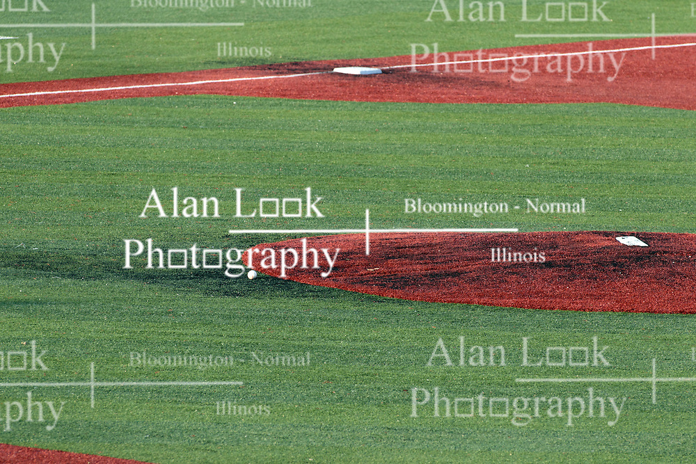 06 June 2014: Baseball lies on the turn in front of the mound during a Frontier League Baseball game between the Frontier Freedom and the Normal CornBelters at Corn Crib Stadium on the campus of Heartland Community College in Normal Illinois