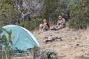 Young backcountry hunters Josh Falkos (left) and Jack Crowley take a break at their camp in the hills east of Dillon, Montana.