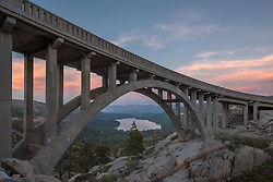 """Sunset at Rainbow Bridge 2"" - Photograph taken at sunset of Rainbow Bridge on Old Highway 40 with Donner Lake and Truckee in the distance."