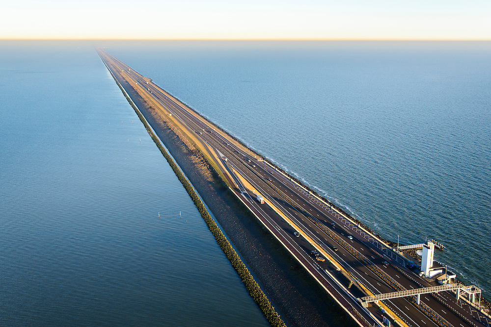Nederland, Noord-Holland, Den Oever, 11-12-2013; Afsluitdijk met Monument, Friesland aan de verre horizon. Waddenzee links in beeld.<br /> Enclosure Dam with Monument. Waddenzee (left), Friesland on the distant horizon.<br /> luchtfoto (toeslag op standaard tarieven);<br /> aerial photo (additional fee required);<br /> copyright foto/photo Siebe Swart.