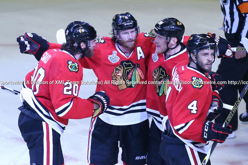08 June 2015:  Chicago Blackhawks Defenceman Duncan Keith (2) [2958] celebrate with Chicago Blackhawks Left Wing Brandon Saad (20) [8995], Chicago Blackhawks Right Wing Marian Hossa (81) [1098] and Chicago Blackhawks Defenceman Niklas Hjalmarsson (4) [5232] after a goal in action during game three of the Stanley Cup Finals between the Tampa Bay Lightning and the Chicago Blackhawks at the United Center, in Chicago, IL.