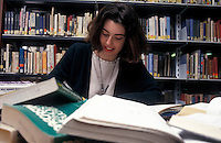 University student studying in the college library.
