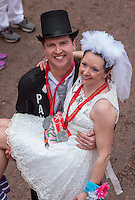 Paul Elliott and Laura Harvey celebrated their marriage after running the first half of the Virgin Money London Marathon.They went on to run the remainder of the race as husband and wife before they could enjoy their wedding reception, Sunday 26th April 2015.<br /> <br /> Photo: Dillon Bryden for Virgin Money London Marathon<br /> <br /> For more information please contact Penny Dain at pennyd@london-marathon.co.uk