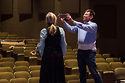 "JULY 8, 2018  LANCASTER, OHIO:<br /> <br /> Director of Theater, A. Victor Jones uses his phone to record video of his best friend and actress, Jennifer Myers, as she acts out a scene on stage in the Wagner Theater during a rehearsal for the production of ""Hello, Dolly!"" at Ohio University Lancaster."