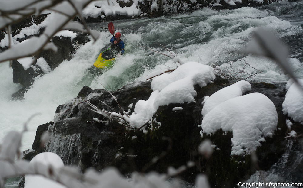 Kayaking the White Salmon River in a snow storm, March 2, 2014, near Husum, Washington.