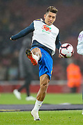 Brazil forward Roberto Firmino (20) warms up prior to the Friendly International match between Brazil and Uruguay at the Emirates Stadium, London, England on 16 November 2018.