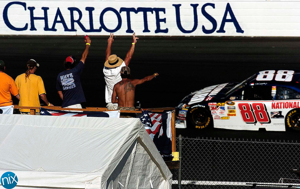 Fans cheer for Dale Earnhardt Jr. during the final Sprint Cup practice Saturday afternoon at Lowe's Motor Speedway. (photo by James Nix)