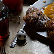 Date: 6/11/10..Food and a soccer ball adorn a table as fans watch the 2010 World Cup opening Group A match between South Africa and Mexico at Madiba, a South African restaurant in Fort Greene, Brooklyn on June 11, 2010.   The game finished in a 1-1 tie. ..Photo by Angela Jimenez for Newsweek .photographer contact 917-586-0916/angelajime@gmail.com