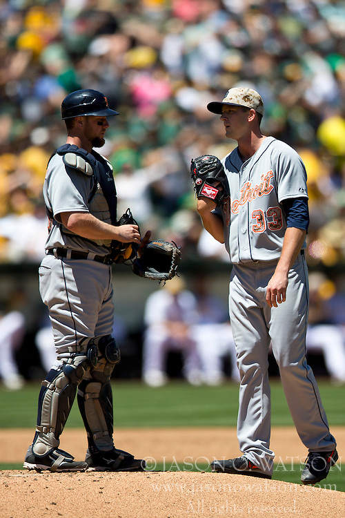 OAKLAND, CA - MAY 26:  Bryan Holaday #50 of the Detroit Tigers talks to Drew Smyly #33 after a home run hit by Yoenis Cespedes #52 of the Oakland Athletics (not pictured) during the third inning at O.co Coliseum on May 26, 2014 in Oakland, California. The Oakland Athletics defeated the Detroit Tigers 10-0.  (Photo by Jason O. Watson/Getty Images) *** Local Caption *** Bryan Holaday; Drew Smyly