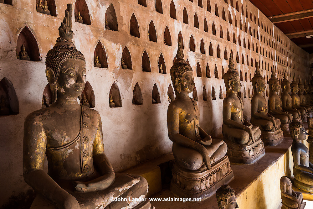 Wat Si Saket located is famous for its cloister wall housing thousands of tiny Buddha images and rows of hundreds of seated Buddhas.  They come in all sizes and are made of wood, stone and bronze.  There are more than 6800 Buddhas in all. If visiting the temple early in the morning, visitors will come across the many locals that go to pray and make merit as well as to offer food to the monks. Wat Sisaket is famous for the interior walls of the cloister and also for its architecture and history.  The temple was built by the last king of the Lang Xang Kingdom, Chao Anuvong and managed to survive the Siamese-Lao war of 1828 and has become the oldest Buddhist monastery in Laos.