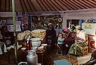 Mongolia. traditional weding  in a yurt in  Atar  little village in the steppe     /  mariage traditionnel  a l interieur de  la yourte  Atar petit village perdu dans la steppe . au milieu de la yourte trone le plateau de produit laitier, crème, fromage seche, et une immense langue de boeuf /  P0009415  b
