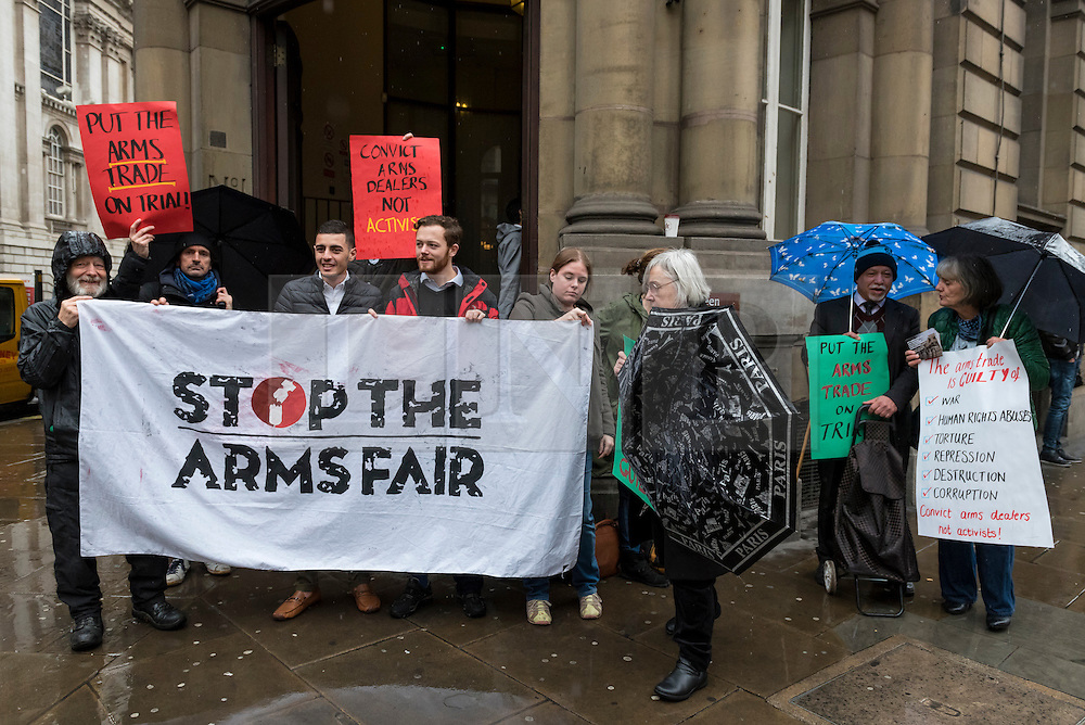 © Licensed to London News Picture 04/11/2016.  London, UK.  4 November 2016.  Supporters gather outside the City of London Magistrates' Court to show solidarity with Bahraini activist Isa (pictured 3rd left), ahead of his court hearing today.  In July 2016, Isa was arrested during protests against the Farnborough International arms fair's gala dinner at the Science Museum as he campaigned to hold the UK government to account over weapons sales. Photo credit : Stephen Chung/LNP