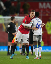 Nemanja Matic of Manchester United (L) and Kwame Poku of Colchester United at the final whistle - Mandatory by-line: Jack Phillips/JMP - 18/12/2019 - FOOTBALL - Old Trafford - Manchester, England - Manchester United v Colchester United - English League Cup Quarter Final