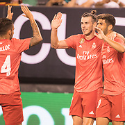 MEADOWLANDS, NEW JERSEY- August 7: Gareth Bale #11of Real Madrid celebrates with team mates Dani Ceballos #24 of Real Madrid and Marco Asensio #20 of Real Madrid after scoring his sides second goal during the Real Madrid vs AS Roma International Champions Cup match at MetLife Stadium on August 7, 2018 in Meadowlands, New Jersey. (Photo by Tim Clayton/Corbis via Getty Images)
