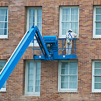 A maintenance worker  repairs a window at Casa Del Mar n Monday, April 23, 2012.