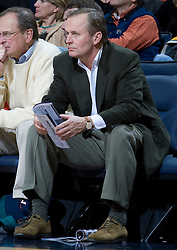 Charlottesville resident and author John Grisham watches from his court side seat.  The Virginia Cavaliers men's basketball team faced the Northwestern Wildcats at John Paul Jones Arena in Charlottesville, VA on November 27, 2007.