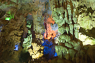 Vietnam, October 2008. The Thien Cung caves.  Ha Long Bay is a UNESCO World Heritage site located in Quang Ninh province, Vietnam. The bay features thousands of limestone karsts and isles in various sizes and shapes. Vietnam is an upcoming player in the travel industry. Photo by Frits Meyst/Adventure4ever.com