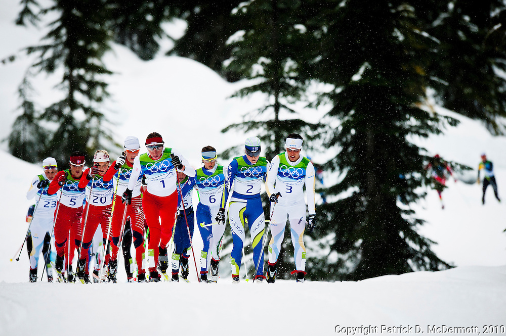 Competitors compete in the women's cross-country skiing 30 KM mass start classic during the 2010 Vancouver Winter Olympics in Whistler, British Columbia, Saturday, Feb. 27, 2010.