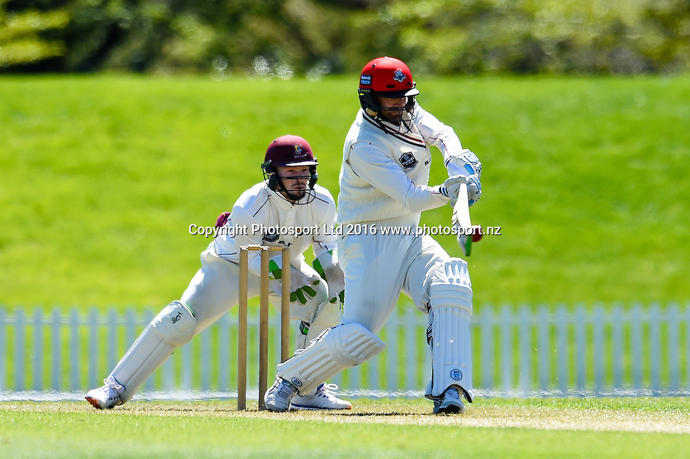 Andrew Ellis of Canterbury pulls the ball with Tim Seifert looking on during Day 1 of the Plunket Shield cricket match, Canterbury V Northern Districts, at Hagley Oval, Christchurch. 22th October 2016. Copyright Photo: John Davidson / www.photosport.nz