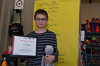 Avery Giunta receives an award in recognition for his outstanding fund raising efforts during the annual Jump Rope for Heart event at Elm Street School.  (Karen Bobotas/for the Laconia Daily Sun)