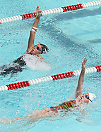 MACR Sharks' Sydney Jones (left), 10, leads Cedar River Waves' Olivia M Thoma, 9, in the Girls 9-10 25 Yard Backstroke event at the All City Swim Meet at Cherry Hill Aquatic Center in Cedar Rapids on Saturday, July 20, 2013. 623 athletes from ages 4-17 participated in the meet.