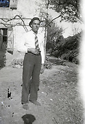 adult male person standing in front of house 1950s rural France