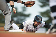 Clayton Dalryprymple, senior, slides back to first base before a University of Nebraska Omaha player tags him during the Wildcats game on Tuesday March 29, 2016. (Photo by Evert Nelson | The Collegian)