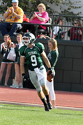 12 October 2013:  Alex Garvey scores during an NCAA division 3 football game between the North Park vikings and the Illinois Wesleyan Titans in Tucci Stadium on Wilder Field, Bloomington IL