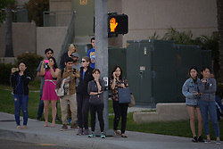 April 30, 2017 - San Diego, CA, USA - A crowd gathers on Sunday, April 30, 2017 at the corner of Golden Haven Drive and Judicial in La Jolla within San Diego, Calif. after reports of a gunman shooting eight victims at a complex in La Jolla. (Credit Image: © Nelvin C. Cepeda/TNS via ZUMA Wire)