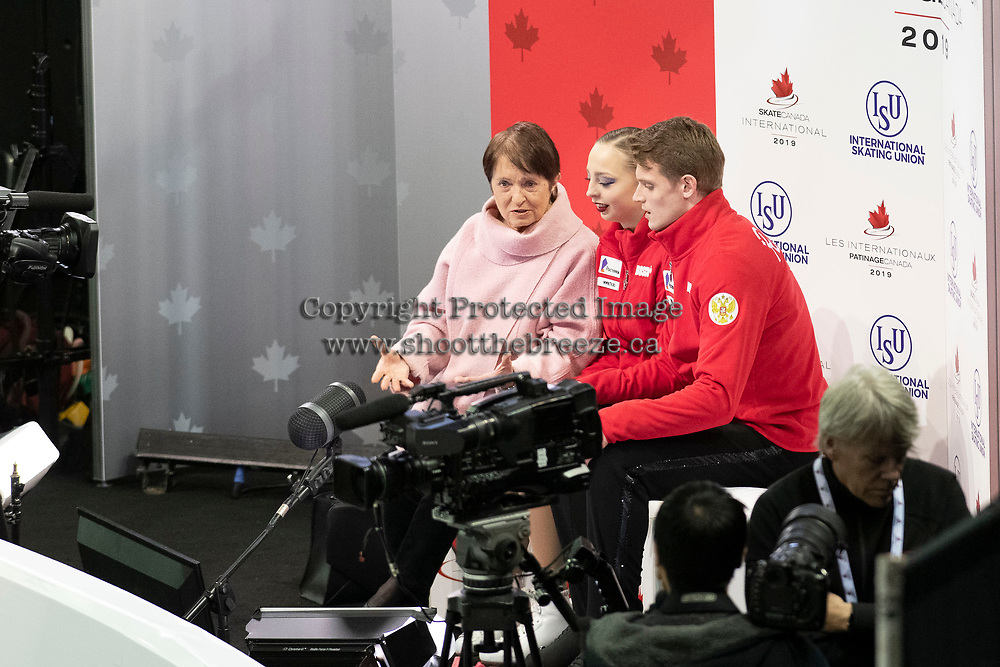 KELOWNA, BC - OCTOBER 26:  Aleksandra Boikova and Dmitrii Kozlovskii of Russia await their score in pairs free skate during Skate Canada International at Prospera Place on October 25, 2019 in Kelowna, Canada. (Photo by Marissa Baecker/Shoot the Breeze)