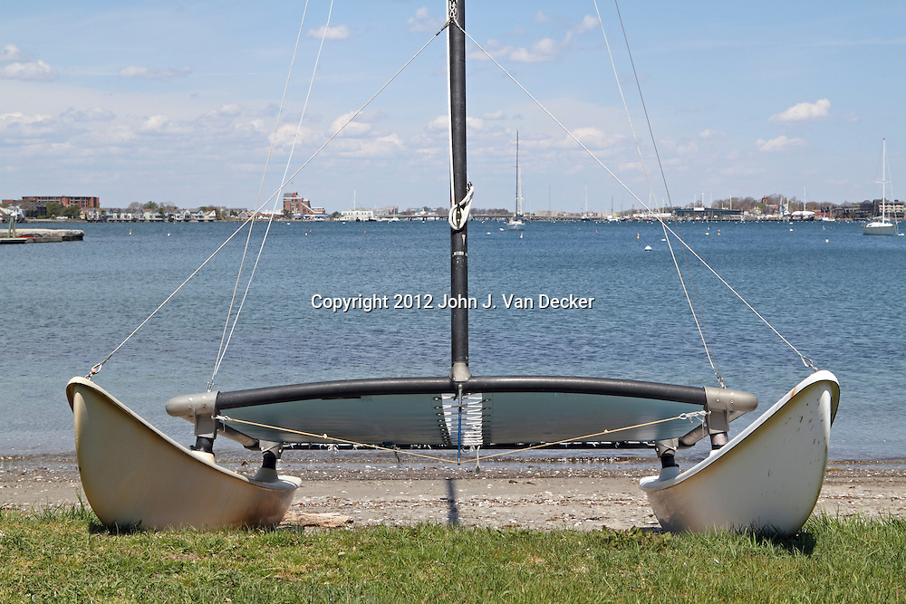 A small sailboat at the waters edge in Newport, Rhode Island, USA
