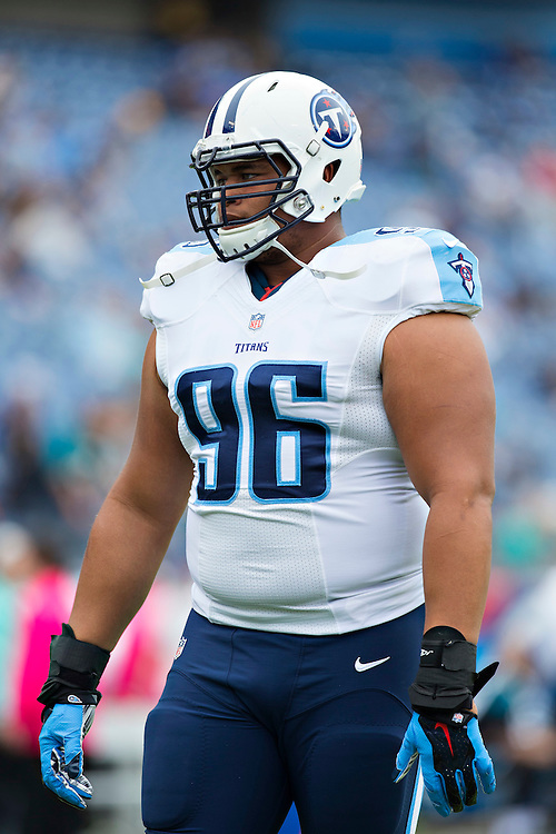 NASHVILLE, TN - OCTOBER 12:  Al Woods #96 of the Tennessee Titans warming up before a game against the Jacksonville Jaguars at LP Field on October 12, 2014 in Nashville, Tennessee.  The Titans defeated the Jaguars 16-14.  (Photo by Wesley Hitt/Getty Images) *** Local Caption *** Al Woods