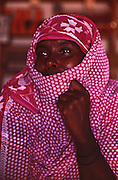 Somali female shopkeeper in Garissa, Northeast Kenya wears headscarf