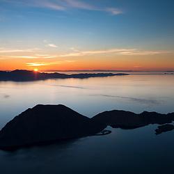 Sun rising over Isla Angel de la Guarda with Isla Smith in the foreground, Gulf of California, Mexico