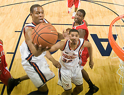 Virginia guard Sean Singletary (44) goes up for a layup against Bradley.  The Virginia Cavaliers fell to the Bradley Braves 96-85 in the semifinals of the 2008 College Basketball Invitational at the University of Virginia's John Paul Jones Arena in Charlottesville, VA on March 26, 2008.