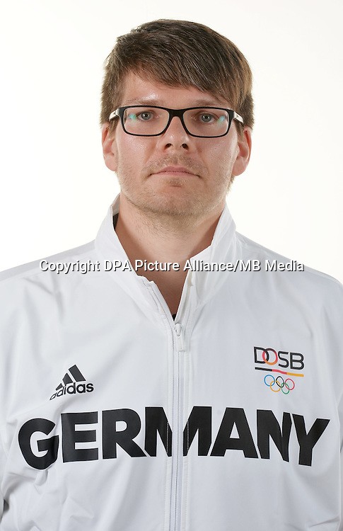 Christoph Bilke poses at a photocall during the preparations for the Olympic Games in Rio at the Emmich Cambrai Barracks in Hanover, Germany. July 04, 2016. Photo credit: Frank May/ picture alliance. | usage worldwide