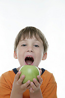 20 July 2008:  Back to School with grammar school Lytle brothers in Huntington Beach, CA.  Matthew Lytle age 6 gets ready to bite into a green apple the studio on white seamless paper silo.