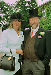 MR & MRS CHRIS WRIGHT head of the Chrysalis Group, at Royal Ascot on 19th June 1997.LZM 10
