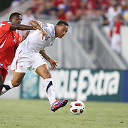 USA midfielder Jermaine Jones (13) dribbles past Panama midfielder Armando Cooper (11) during a  CONCACAF Gold Cup soccer match between the United States and Panama on Saturday, June 11, 2011, at Raymond James Stadium in Tampa, Fla. (AP Photo/Alex Menendez)