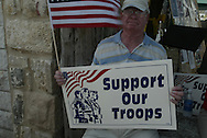 a Bush and Troops supports counter protests near the Yellow Rose during the Cindy Sheehan Vigil
