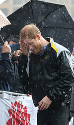 Prince Harry wipes water from his face as he meets members of the public on a walkabout on Circular Quay in Sydney, Australia, during a day of events to mark the official launch of the Invictus Games Sydney 2018.