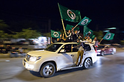 LNP Weekly Highlights 02/05/14. FILE PICTURE. © Licensed to London News Pictures. 27/04/2014. Sulaimaniya, Iraq. Supporters of the Patriotic Union of Kurdistan (PUK) political party fly flags from their car during celebrations in the lead up to the 2014 Iraqi parliamentary elections in Sulaimaniya, Iraqi-Kurdistan.<br />