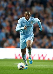MANCHESTER, ENGLAND - Monday, April 30, 2012: Manchester City's Yaya Toure in action against Manchester United during the Premiership match at the City of Manchester Stadium. (Pic by Chris Brunskill/Propaganda)